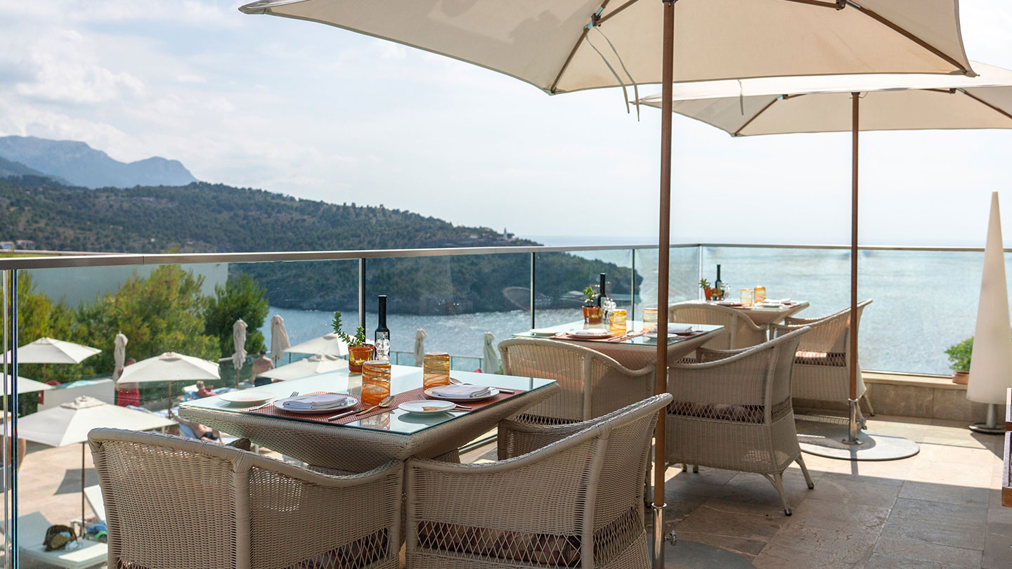 Restaurant tables on terrace overlooking Port Soller