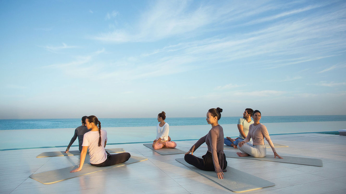 Women enjoying yoga on the beach