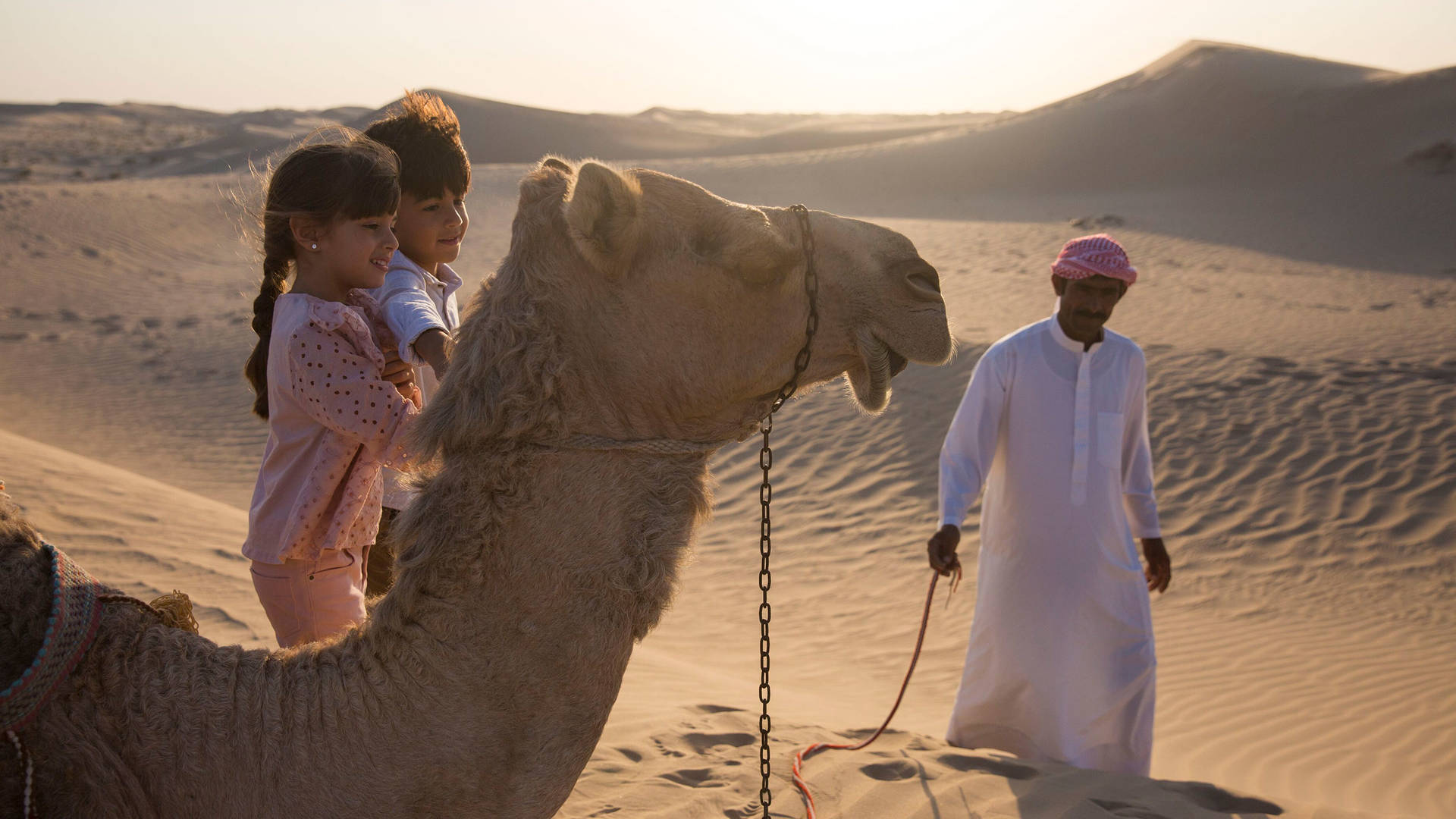 Children and a camel