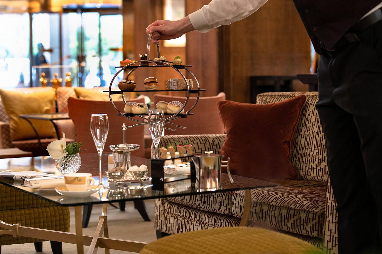 Jumeriah Carlton Tower Chinoiserie Waiter Placing Tea Tray